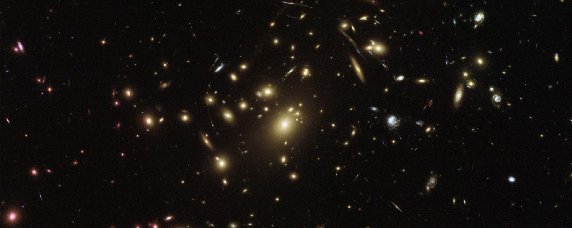 A Hubble Space Telescope image of Galaxy cluster Abell 2537. The amount of gravity, that is, warping of spacetime, caused by this galaxy is visible through the bending of the light of stars and galaxies behind Abell. The galaxy works as a lens. All is predicted by Einstein's General Relativity.