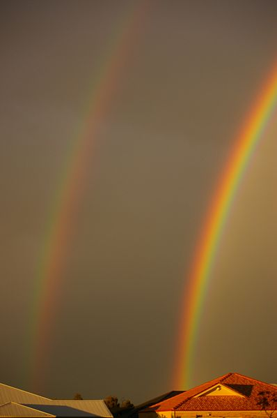 Two rainbows. The air underneath the primary is brighter than the air in between the primary and the secondary rainbow.